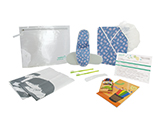 HOSPITEN CHILD OUTPATIENT KIT (PVC) | Personalised PVC case with cap, gown and printed child's slippers, toothbrushes with toothpaste, shoehorn, bags for patient's clothes and shoes, colouring book and crayons and outpatient information card.