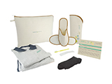 HOSPITEN CHECK-UP KIT (FABRIC) | Personalised fabric washbag with polo shirt and sweatpants, toothbrush with integrated toothpaste, shoehorn, socks, slippers in a personalised open case and instruction card.
