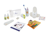 GÉNÉRALE DE SANTÉ CHILD HYGIENE KIT (PVC) | Personalised PVC washbag with gel/shampoo, body lotion, soap, comb, dental training kit, colouring book and crayons, child slippers in a personalised open case, welcome card and patient guide.