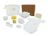 HOSPITEN MATERNITY KIT (LEATHERETTE) | Personalised leatherette layette with sponge, brush and comb, dummy, keyring, mittens, bib, cap, hooded baby towel, formula dispenser and congratulations card. Presented in a personalised cardboard case.