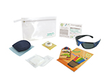 HOSPITEN CHILD LASER EYE SURGERY KIT (PVC) | Personalised PVC washbag with sleep mask, tape, gauze, sterile occluder, infant dark glasses, colouring book and crayons, and information card.