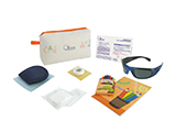 GÉNÉRALE DE SANTÉ CHILD LASER EYE SURGERY KIT (PVC) | Personalised fabric washbag with sleep mask, tape, gauze, sterile occluder, infant dark glasses, colouring book and crayons, and information card.